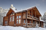 Fototapety Log home winter with large windows, balcony and porch, daytime.