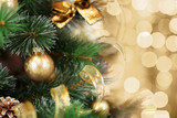 Fototapety Christmas tree with gold blurred light background