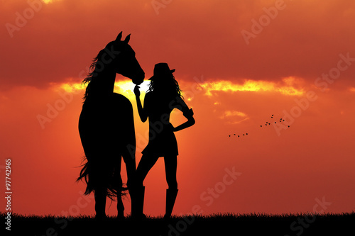 Tuinposter Baksteen girl and horse silhouette at sunset