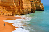 Benagil, Algarve, Portugal - October 27, 2015: Tourist walking on Benagil Beach on the Algarve coast