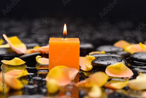 Orange rose petals with candle and therapy stones  © Mee Ting