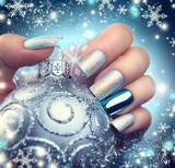 Fototapety Christmas nail art manicure. Winter holiday style bright manicure design