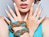 woman hands nails manicure fashion blue jewelry. Female hands wi