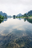 Transparent water with oddly shaped Karst hills, Yangshuo, Guangxi Province, China