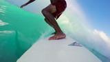Surfer on Blue Ocean Wave Surfing Getting Barreled. POV GOPRO SELFIE