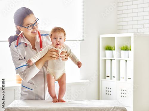 doctor examining a baby Plakat