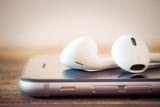 Fototapety closeup modern headphone on phone media portable