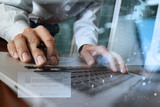 "hands using laptop and holding credit card with ""Secure payment"""