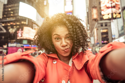 Young american woman taking selfie in New york, Time square Poster