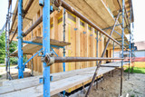 scaffold on a residential hard wood passive house