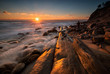 Rocky sunrise. A young man welcomes first rays at a rocky Black Sea coast, Bulgaria.