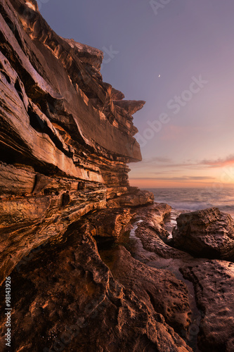 Rocky seascape with Moon