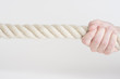 Hand holding strong rope