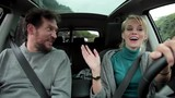 Cool happy woman driving car with boyfriend laughing
