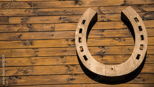 Horseshoe hanging on a wooden wall