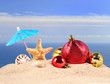 Quadro Christmas decorations, seashells and starfish on a beach sand