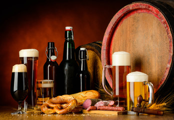 Beer and sausages on rustic table