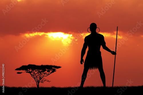 Foto op Canvas Baksteen Indigenous man at sunset