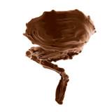 splash of brownish hot coffee or chocolate
