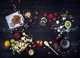 """Raw cakes and fresh fruits 98276725,Chamomile tea on wooden background"""""""