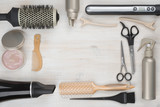 Fototapety Hairdressing tools on wooden background with copyspace in the middle