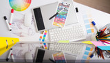 Fototapety Modern office workplace with digital tablet, notepad, colorful p