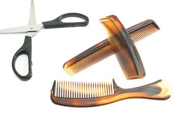 scissors and combs on white