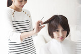 Women are cut the hair to hair stylist