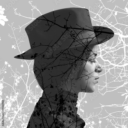 Double exposure of girl wearing hat and tree branches - 98382982
