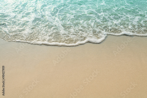 Sand beach and wave of the sea