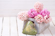 Pink hyacinths flowers  in box  and green decorative heart