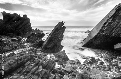 Ocean studded with rocks Plakat