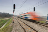 Blurred train of Koleje Malopolskie on double railway track, Krakow, Poland