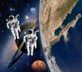 Two astronauts spaceman solar system saturn mars planet moon sci fi space. Elements of this image furnished by NASA.