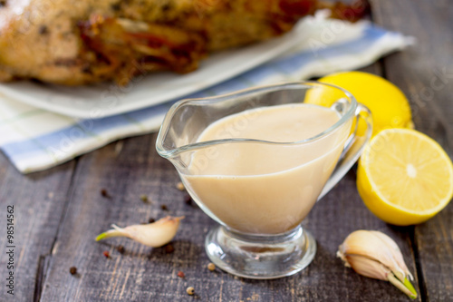 Poster Honey-lemon sauce for marinating poultry, selective focus