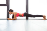 Sports woman doing plank exercise - 98557713