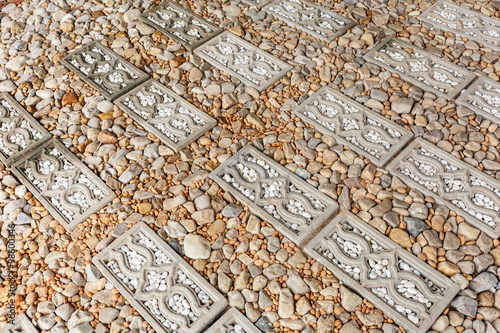Poster Walkway surface made of gravel grainy , stone and bricks for bac