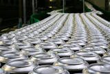 Conveyor line carrying thousands aluminum beverage cans at factory