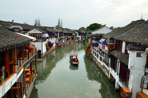 Plakát, Obraz Old village by river in Shanghai with boat..