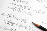 Maths concept - handheld calculator and pencil over a sheet of paper with maths-formulas - 98638511