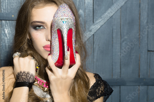 Plakat Fashionable woman with shoe