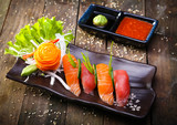 Japanese Salmon, tuna sushi and sauce closeup