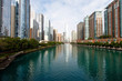 Color DSLR wide angle view of Chicago city skyline as seen up the river; horizontal with copy space for text