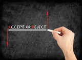 Accept or reject - hand writing text on chalkboard.