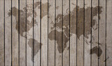 world map overlaid on brown wooden texture patterned background