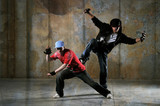 Two hip-hop dancers performing