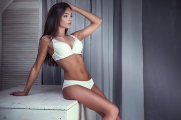 Romantic brunette girl in lingerie.