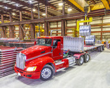 Fototapety Red truck being loaded in the bay under ceiling lights