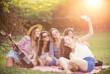 Happy female friends having fun outside in nature