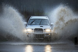 Driving on a flooded country road poster